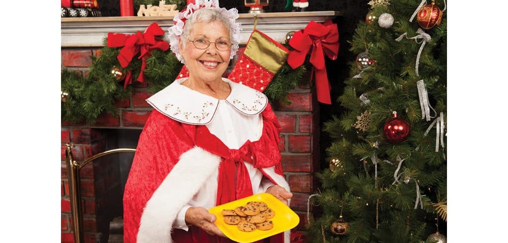 Mrs. Claus holding her award-winning chocolate chip cookies. Photo courtesy of Hermey Donner